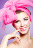 Woman in pink. Beautiful smiling girl with pink makeup and bow Stock Photo