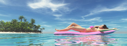 Woman on pink air bed Stock Photo