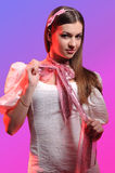 Woman on a pink background Stock Photography