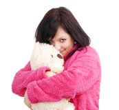 Woman in Pink Bathrobe Cuddling with her Teddy Bear Stock Photos