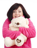 Woman in Pink Bathrobe Cuddling with her Teddy Bear Stock Photo