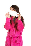 Woman in pink bathrobe with menstruation pad. Stock Image