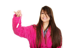 Woman in pink bathrobe with tampon. Royalty Free Stock Images