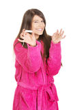 Woman in pink bathrobe with tampon. Stock Photos