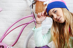 Woman with pink  bike at home Stock Images