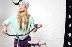 Woman with pink  bike at home Stock Image
