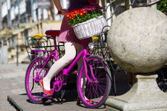Woman on a pink bike. On the street of an old town in Gdansk, Poland stock photos