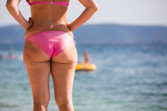 Woman in pink bikini at a beach Stock Photography