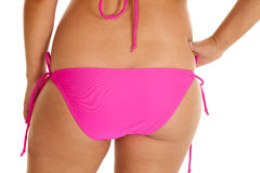 Woman pink bikini bottom butt. A close up of a woman in her bikini showing her bottom Royalty Free Stock Photography