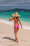Woman in pink bikini on tropical beach. At Thailand Stock Photo