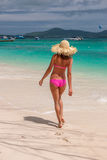 Woman in pink bikini on tropical beach. At Thailand Stock Images