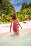 Woman in pink bikini on tropical beach. Woman wearing pink bikini on tropical beach at Thailand Stock Photo