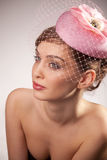 Woman in pink bonnet with voile. Portrait of pretty young woman in pink bonnet with voile. Vintage Make-up Stock Images