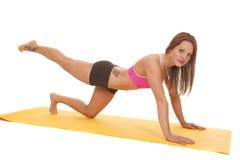 Woman pink bra fitness mat push leg out Stock Photo