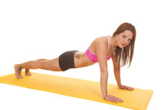 Woman pink bra fitness mat push up Royalty Free Stock Image
