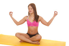Woman pink bra yoga meditate facing Stock Image
