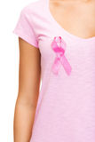 Woman with pink cancer awareness ribbon Stock Photos