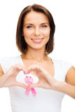 Woman with pink cancer ribbon Stock Images