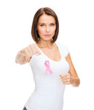 Woman with pink cancer ribbon Stock Photo