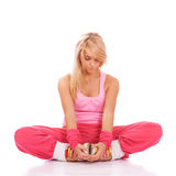 Woman in pink clothes doing fitness Stock Photos