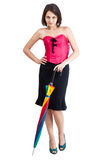 Woman in pink corset. Beautiful young woman in pink corset with rainbow umbrella isolated on white background stock photo