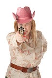 Woman with pink cowboy hat pointing pistol Royalty Free Stock Photography