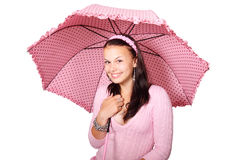 Woman with pink dotted umbrella isolated. Young woman in pink smiling with pink dotted umbrella isolated on white Stock Image