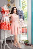 Woman in Pink Dress in Fashion Store Stock Image