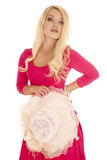 Woman pink dress frilly hat holding Stock Image