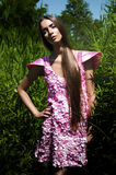 Woman in pink dress in high grass Royalty Free Stock Photo