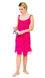 Woman in pink dress holding shoes Royalty Free Stock Images