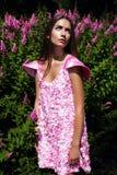Woman in pink dress looking at sun Stock Photos