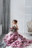 Woman in pink dress. With a lush bouquet of flowers royalty free stock photos