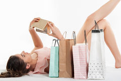 Woman in pink dress opening a present box royalty free stock photos