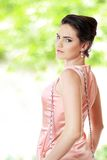 Woman in pink dress outdoor Stock Photography