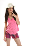 Woman in pink dress and round cap have fun standi Stock Photography
