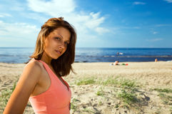 Woman in pink dress on seacoast Stock Photography