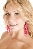 Woman with pink ear rings Royalty Free Stock Photos