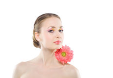 Woman with a pink flower. Woman with a pink flower on a white background Royalty Free Stock Image