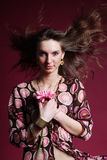 Woman with pink flower. & wind hair Stock Photography