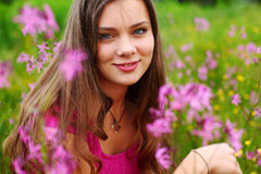 Woman on pink flower field royalty free stock photos