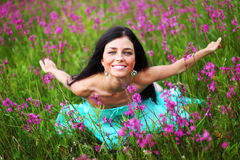 Woman on pink flower field stock photo