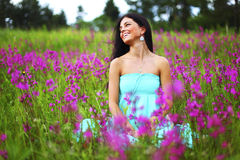 Woman on pink flower field Royalty Free Stock Image