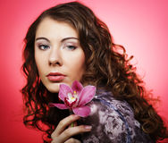 Woman with pink flower over pink background Royalty Free Stock Photo