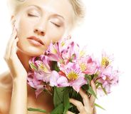 Woman with pink flowers Stock Images