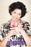 Woman with pink flowers Stock Photography