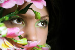 Woman with pink flowers. Focus on eyes royalty free stock photos