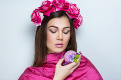 Woman pink flowers Stock Images