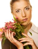 Woman with pink flowers Royalty Free Stock Photography