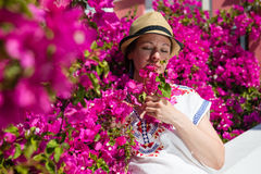 Woman with pink flowers Royalty Free Stock Photo